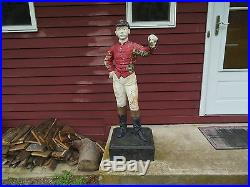 Antique lawn jockeys, two, each one is signed by the foundry