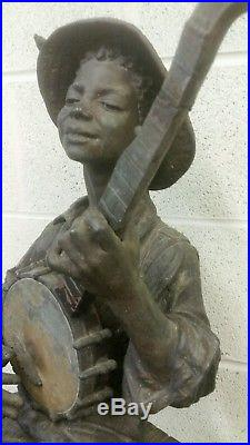 Big Antique Metal Figure Of A Negro Boy Playing Banjo 30 Inches Tall