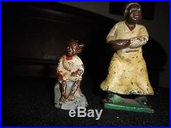 Black Americana antique C. I. Figures or toys, Mother and daughter iron decor
