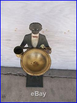 Black americana cast iron and brass ash tray-butler