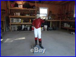 Custom concrete cavalier lawn jockey