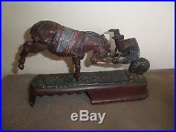 Nice old original cast iron I Always did Spise a Mule mechanical bank Pat. 1879