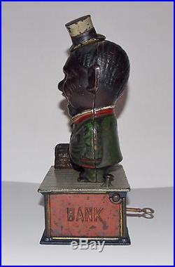 ORIGINAL ANTIQUE BLACK AMERICANA CAST IRONSTUMP SPEAKERMECHANICAL BANK C1886