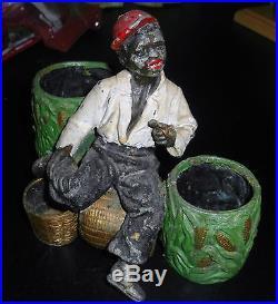 Old Vintage Cold Painted Lead Black Boy Smoking Pipe Sitting On Corn Basket