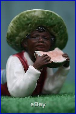 SUPERB 19thC MAJOLICA BLACKAMOOR RECUMBENT MALE FIGURE EATING MELON SLICE c1890s