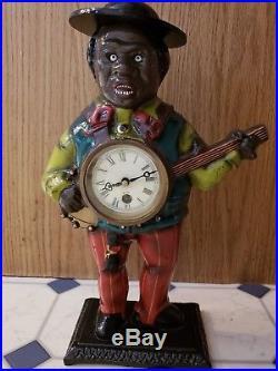 Sambo Clock Statue, playing banjo
