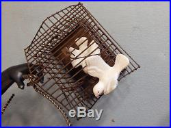 Vintage Large Petites Choses Blackamoor Figurine / statue, Man with Bird Cages